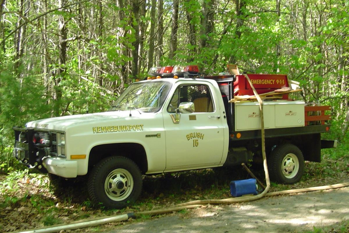 Brush 15: 1984 GMC Brush Unit - 4 wheel drive, 250 gallon water tank, winch, floating pump, Indian tanks Purchased by the Kittredge Family Fire Equipment Fund.