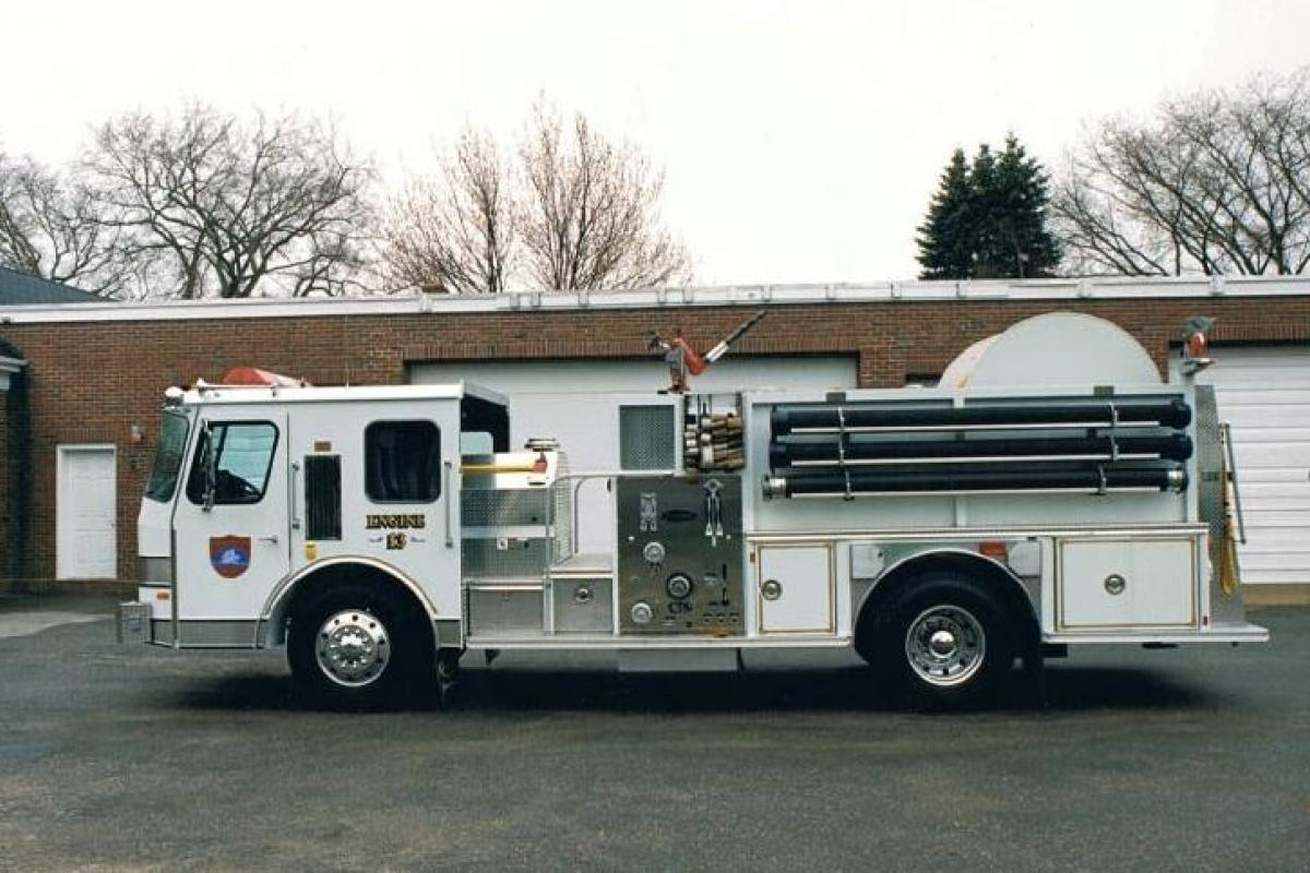 """Engine 13: 1989 E-One """"Hose Monster"""" - 1500 GPM pump, 500 gallon water tank, 3000' 4"""" hose on reel Purchased by the Kittredge Family Fire Equipment Fund."""