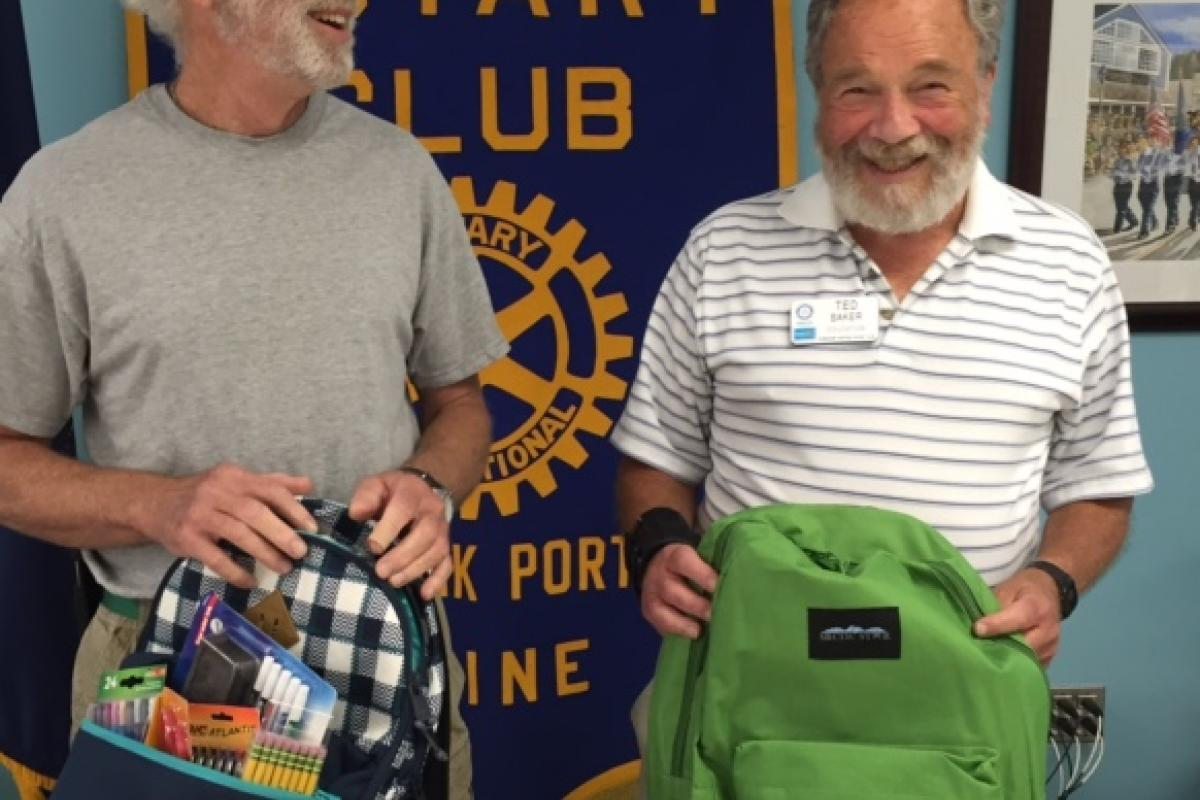 """Portside Rotary helping with """"stuff the backpack"""" project 2016"""